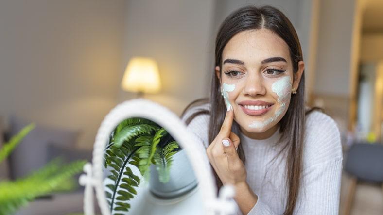 Woman applying a face masque