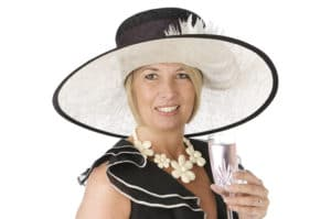 Lady at a wedding wearing a hat