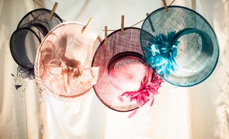 Four hats hanging on a washing line