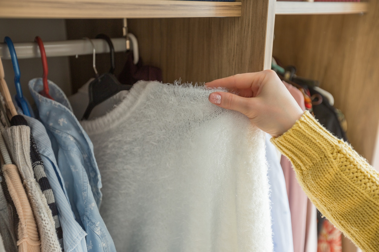 Woman selecting something from her wardrobe